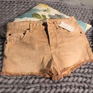 Khaki Free People shorts.